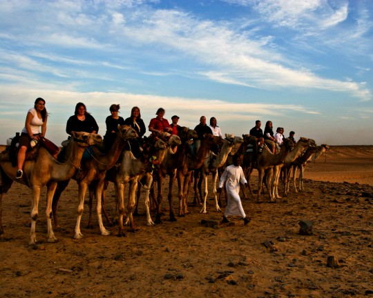 Aswan Tourists on Camel Back
