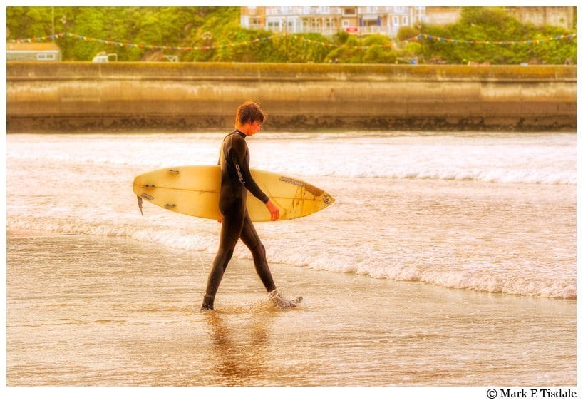 Cornwall Photo - Surfer heading out into the waters of Newquay