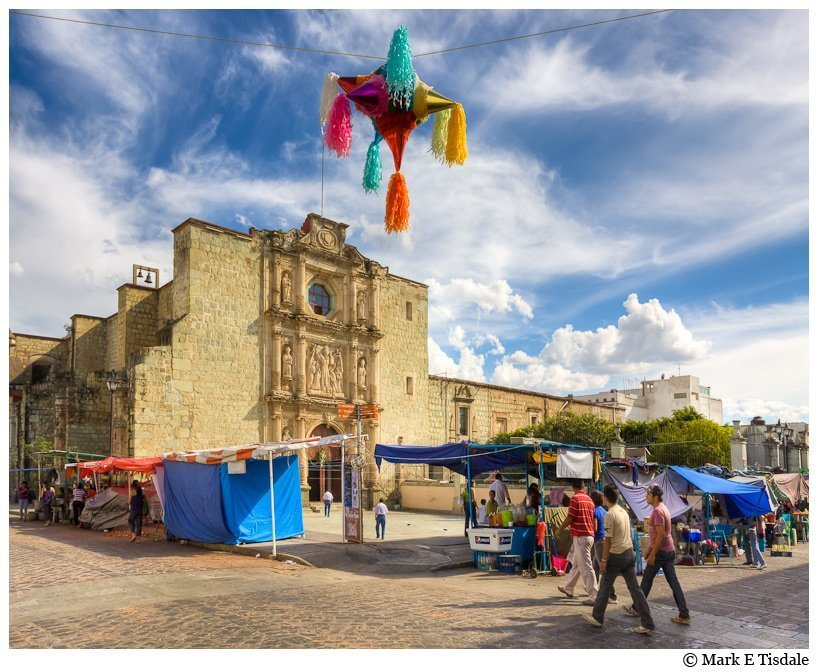 Picture of a market in front of a colonial church in Oaxaca Mexico
