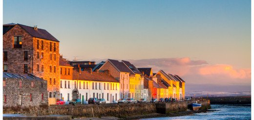 Photo of colorful houses on the seaside in the warm sunlight in Galway Ireland
